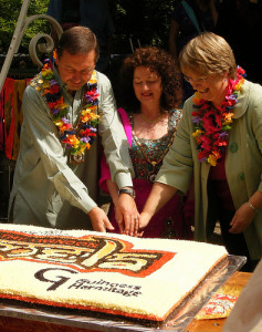 Cutting the Mela cake